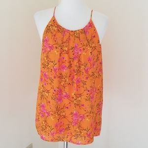 Violet + Claire large orange floral springy top.